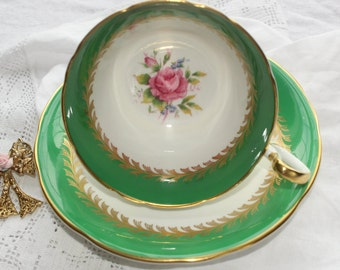 Aynsley, England:  Green tea cup and saucer with pink flower