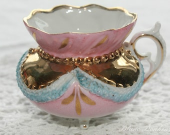 German:  Antique small pink & gold lovely footed demitasse