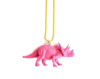 Triceratops dinosaur necklace ~ jurassic park pink toy dino jewelry