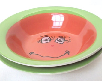 Cereal bowls - Trade Winds Funny Faces - Expressions - set of two green with orange bowls