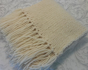 Nice scarf knitted with a fringe. Keep warm with elegance.