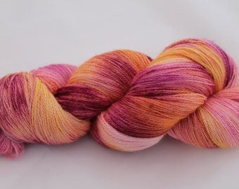 Hand Dyed Yarn in the Fruit Salad colourway.  Lace weight Variegated Merino, Silk yarn. 100g. 800m, 875 yards of pink, orange, yellow peach