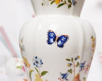 "A large  Aynsley ""Cottage Garden""  vase: English bone china decorated with beautiful English cottage garden flowers."