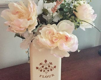 Spring floral arrangement in flour canister- fixer upper- farmhouse- pottery barn style