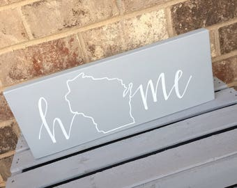 hand lettered HOME sign.