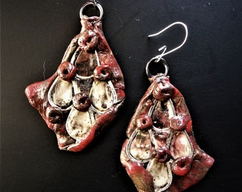 "Earrings ""4483""""carried out in block polymer and metal"""
