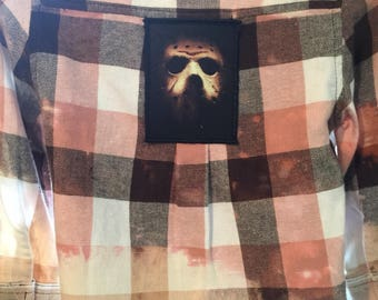 Distressed and bleached flannel with Jason Voorhees patch.