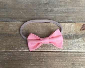 Pretty Pink Baby Bow, baby bows, baby headbands, baby accessories, nylon headbands, baby clip bows, baby clips, pink baby bows, bow on nylon