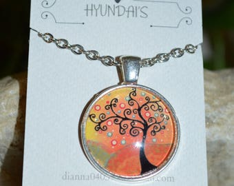Who doesn't like a family tree necklace? well here is a beautiful one