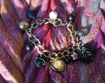 Handmade charm bracelet with vintage pieces.