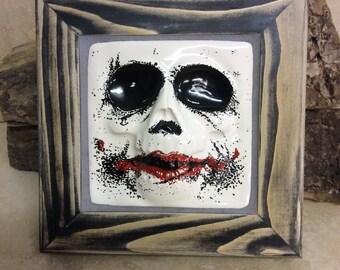 Handmade ceramic Joker/ skull inspired tile in frame
