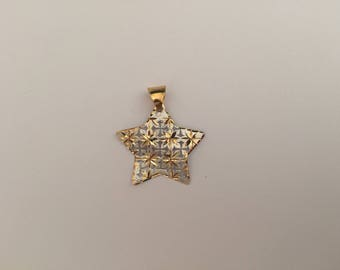 Star shaped pendant in white and yellow 18k gold.