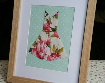 Vintage floral print origami dress, set in a wooden frame.