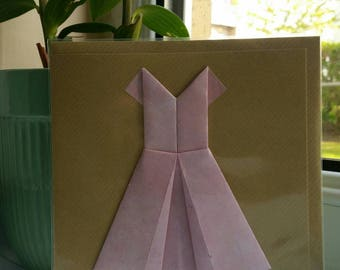 "Origami pink dress on a 6x6"" greeting card."