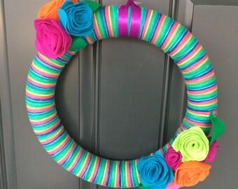 Rainbow yarn wreath with felt flowers