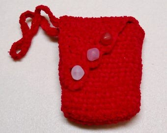 small red crochet bag with toning red and pink closures, tarot deck sized