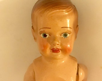 Hard bodied vintage doll with painted face and hair