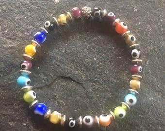 "Glass ""evil eye"" beaded stretchy bracelet"