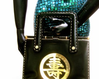 1970s Sleek Asian Emblem Black Leather Handbag