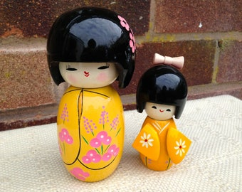 2 x Japanese Kokeshi wooden dolls. Collectables/Japanese dolls/Display/Traditional dress dolls/yellow kimono Kokeshi/hand made/figurines.