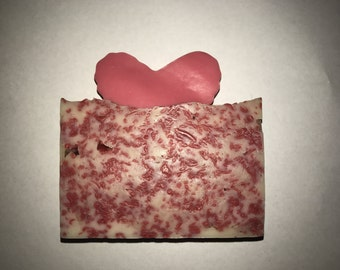 Red confetti with pink heart soap.