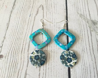 Unique silver earrings with denim blue flower shell beads and glacial blue beads.