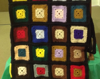 Black and multicolor granny square afghan
