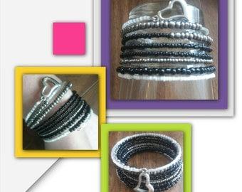 Black and white beaded heart spring bracelet