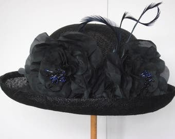 Giselle navy sinamay bowler-style hat with silk flowers, beads, ribbon and feathers