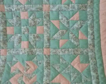 Peach and green, hand quilted, queen size quilt