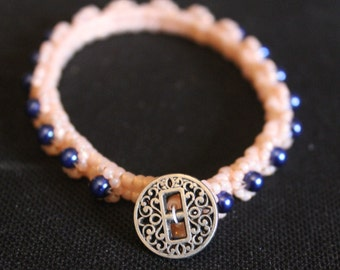 Blue and Peach bracelet with button clasp