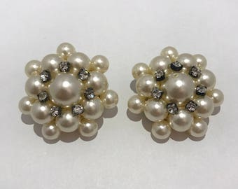 Huge clips of ears in plastic beads and white rhinestones. Vintage big earrings clips 1980