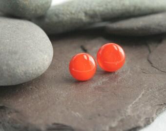 Orange glass stud earrings.