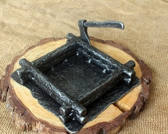 Fully hand forged ashtray with an axe and blockhouse