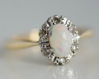 18 ct gold ring with opal and diamonds/18 ct gold opal and diamond ring