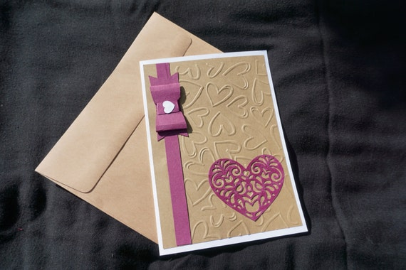 Wine and brown embossed card with heart and bow.