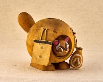 Tanuki raccoon with sake bottle, folklore spirit. Yōkai demon. Made of wood. Vintage, Japanese Figurines.