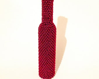 Red Bead Wrapped Wine Bottle