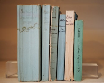 6 Light blue/green paper-bound antique books