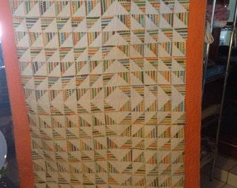 Freedom Style, triangles stripes, orange multi color and white.