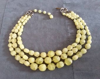 Vintage lemon colored three strand necklace odd beads. Hook has Kramer on it.