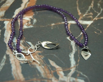 Flourish silver pendant & Amethyst bead necklace