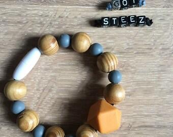 Wooden teething bracelet - mustard