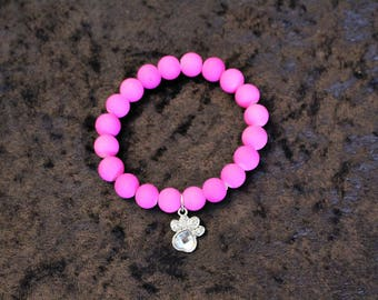 A Fun Fluorescent Hot Pink Stretch Bracelet with a Charm
