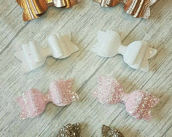 Glitter leatherette bow clips