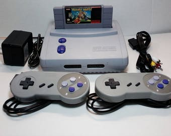 SNES 2 SNS-101 Jr Mini Super Nintendo Entertainment System Console, 2 Controllers, Ac Adapter, AV Cable, Wario's Woods Game Cleaned Tested