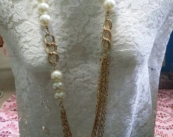Long Multi chain and large faux pearl necklace