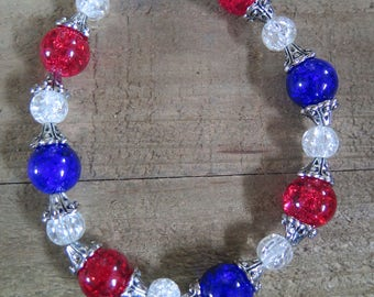 Blue, red and white beaded stretch bracelet