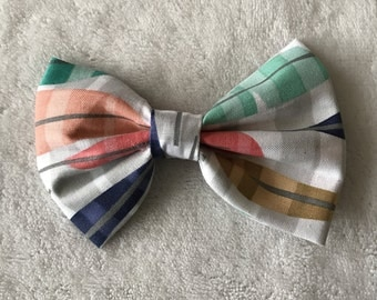 Light gray bow with multi colored feathers