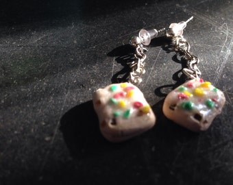 Pop tart dangly down earrings.